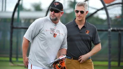 Orioles manager Brandon Hyde and general manager Mike Elias watch players during spring training in Sarasota, Florida.
