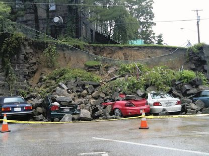 Retaining wall collapses, damages vehicles in Ellicott City