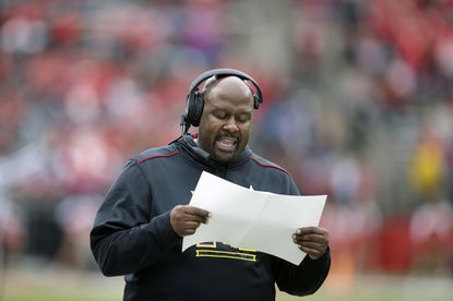 Maryland interim coach Mike Locksley shouts as he walks the sidelines during the first half against Rutgers.