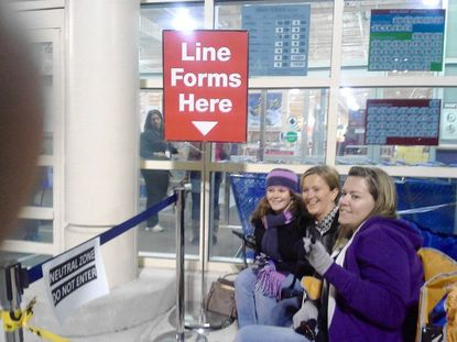 Waiting for Toys R Us in Towson Marketplace to open Thursday night are, from right, Michelle Markiewicz, 28, of Parkville; Stefanie Lord, 30, of Harford County; and Nora Lee Cockerham, 21, of Highlandtown. They were the first ones on line as Black Friday got off to an early start.