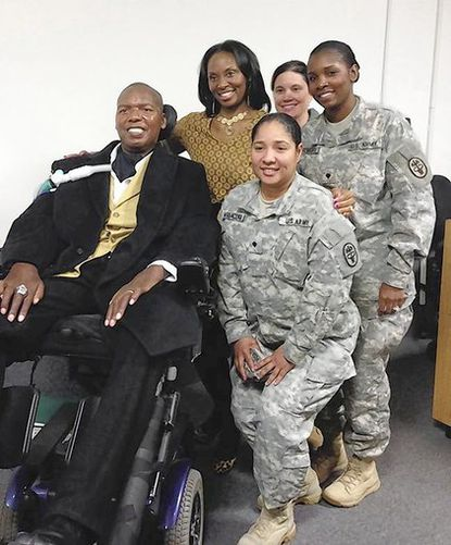 O.J. and Chandra Brigance meet with soldiers at Aberdeen Proving Ground where the couple spoke Wednesday at an event honoring the contributions of disabled Americans.