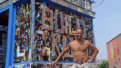 In this July 3, 2015, photo, Loring Cornish poses at the former police substation at Charles and Lanvale streets, which he covered in a mosaic.