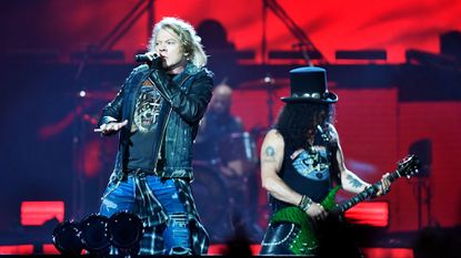Axl Rose (left) and Slash of Guns N' Roses are photographed during a June 2017 performance in Sweden. The veteran rock act headlined Capital One Arena in Washington on Thursday night.