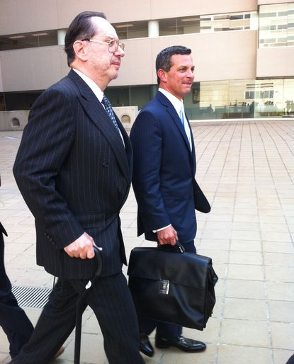 Barry Landau and attorney Steven Silverman leave the federal courthouse after sentencing Wednesday.