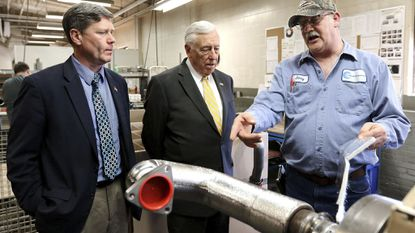 Jerry Olson, right, of Culimeta-Saveguard in Eau Claire, Wis., gives a tour to Rep. Ron Kind, D-Wis., left, and House Democratic Whip Steny Hoyer. Hoyer headed to Trump country this week in a last-chance campaign for the top spot.