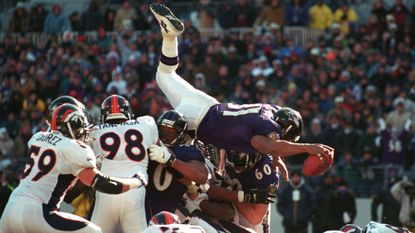Ravens running back Jamal Lewis dives over the pile for his first of two touchdowns in the Ravens' 21-3 win over the Denver Broncos in an AFC wild-card game Dec. 31, 2000, at PSINet Stadium.