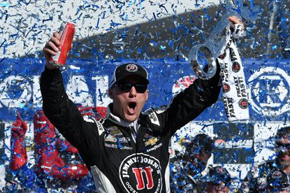 NASCAR driver Kevin Harvick celebrates after winning the Sprint Cup Kobalt 400 on Sunday in Las Vegas.