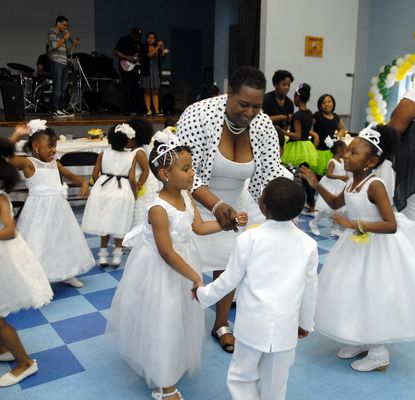 Crystal Hardy-Flowers, the owner/director of Little Flowers Early Childhood & Development, dances with children at a cotillion in 2018. She died of COVID-19 complications in Dec. 31.