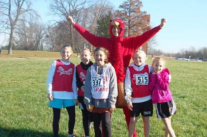 From left, Madison Liggett, Mackenzie Bell, Sophia Wrisk, Caitlyn Baeck, Elizabeth Kennedy were among more than 600 participants who took part in the annual Turkey Trot on Thanksgiving morning.