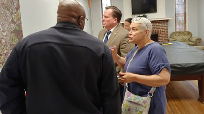 Beth Varnau, right, discusses parking issues with Mayor Craig Moe, center, and Keven Gray, deputy chief of police on Monday.