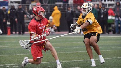 Maryland's Jared Bernhardt, left, plans to play football after exhausting his lacrosse eligibility.