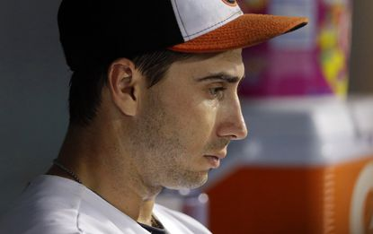 Orioles starting pitcher Miguel Gonzalez sits in the dugout in the fifth inning against the Minnesota Twins, Thursday, Aug. 20, 2015, in Baltimore. Minnesota scored seven runs against Gonzalez before he was relieved in the sixth inning.