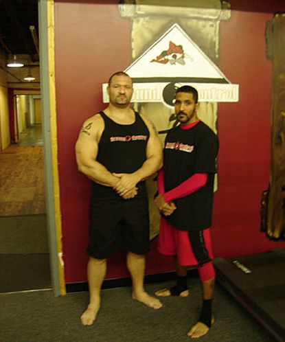 Ground Control's John Rallo (left) and Binky Jones have been friends since playing youth football together as kids in Baltimore. Both men used wrestling skills learned at local high schools as a bridge to mixed martial arts.