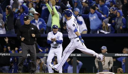 Kansas City Royals' Alex Gordon celebrates after hitting a solo home run during the ninth inning of Game 1 of the World Series against the New York Mets on Tuesday.