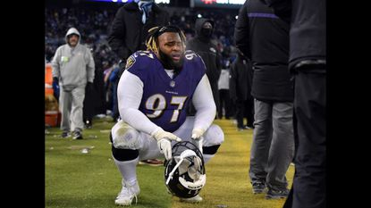 Ravens' #97 Michael Pierce in disbelief after the Cincinnati Bengals scored a late fourth-quarter touchdown to take the lead and beat the Ravens. Baltimore Ravens vs. Cincinnati Bengals NFL football at M&T Bank Stadium.
