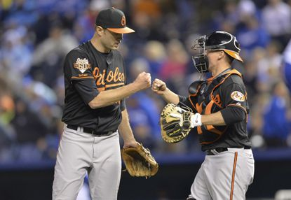 Chris Tillman celebrates with Steve Clevenger after throwing a complete-game shutout against the Kansas City Royals.