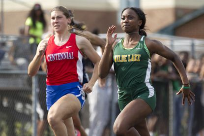 Wilde Lake's Jamila Brown, right, races against Centennial's Kathleen Amstead, left, during the girls 100-meter dash during the Howard County Outdoor Track Championships at Wilde Lake High School in Columbia on Tuesday, May 5, 2015.