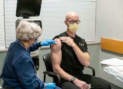Dr. Michael Winters of Mount Airy was among the first Marylanders to receive the COVID-19 vaccine on Monday. He is one of the University of Maryland Medical System's frontline health care workers and is a professor of emergency medicine at the University of Maryland medical school.