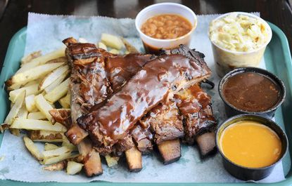 "Pictured is Midtown's Legendary 1/2-rack rib. Nathan Beveridge and Tony Harrison took over the Midtown Yacht Club and turned it into <a href=""http://findlocal.baltimoresun.com/listings/mr-beveridges-midtown-yacht-club-baltimore"">Midtown BBQ &amp; Brew</a>."