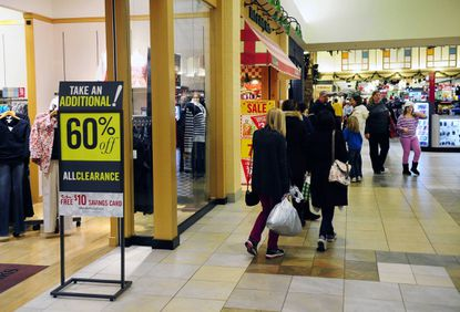 Shoppers roam Harford Mall in Bel Air early Wednesday evening, returning Christmas gifts and searching for bargins.