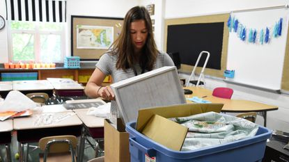 With the first day of school only days away, first year teacher Kyla Lanchak works to prepare her fourth grade classroom at Forest Hill Elementary School.