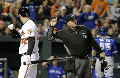 Home plate umpire Dan Bellino, right, ejects Baltimore Orioles' Matt Wieters after Wieters struck out to end the fifth inning of a baseball game against the Toronto Blue Jays in Baltimore, Thursday, April 21, 2016.
