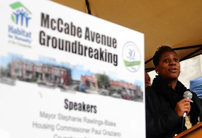 Monica Gaines, president of the Woodbourne/McCabe Community Association, thanks Habitat for Humanity for helping to rebuild the community during a groundbreaking ceremony Nov. 13.