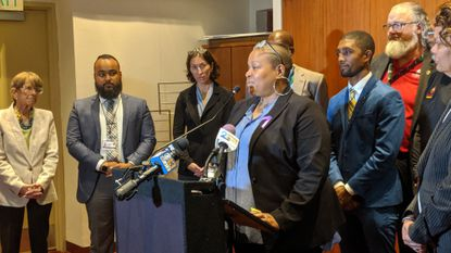 Tonya Wilson, the mother of the late Maryland football player Jordan McNair, speaks to reporters Oct. 7, 2019, about a bill that would require leaders of youth sports programs at Baltimore's youth recreation centers to undergo additional training.