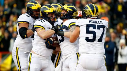 Michigan fullback Henry Poggi, second from right, celebrates his touchdown with teammates in the first half of a game against Maryland in College Park on Saturday, Nov. 11, 2017.