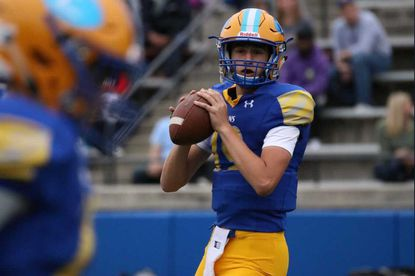 Loyola Blakefield quarterback Joe Eldredge warms up prior to a game in 2019.