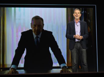 """Netflix CEO Reed Hastings delivers a keynote address in front of an image of actor Kevin Spacey from """"House of Cards"""" at CES 2016 at The Venetian Las Vegas on Jan. 6. CES is the world's largest annual consumer technology trade show."""