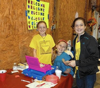 Glenwood Middle School students Ellie Feaga, Caroline Glassman and Julie Hockstra sell raffle tickets for last year's charity bake sale.