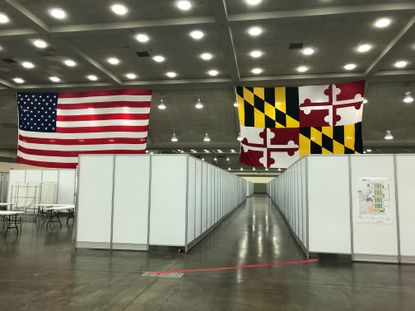 The Baltimore Convention Center has been turned into a field hospital amid a surge of coronavirus cases in the state. The site is now equipped with 250 private beds, bathrooms and hand washing stations.