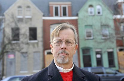 Steve Walters, economics professor at Loyola University Maryland, says the city could turn itself around if it cuts its property tax rate. He is shown in the Barclay neighborhood.