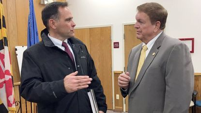 Harford County Del. Andrew Cassilly, left, talks with Maryland Transportation Secretary Pete K. Rahn following Rahn's presentation on local transportation projects in the Harford County Council chambers in Bel Air Monday.