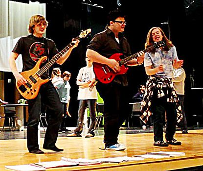 """In a rehearsal for the Manchester Valley High School production of """"The Wedding Singer,"""" David Klima, Kevin Sparks and Noah Maenner perform as members of Simply Wed: Sammy, Robbie and George."""