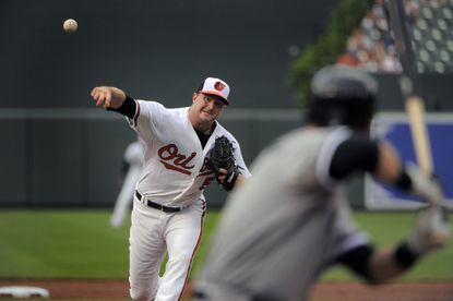 Orioles pitcher Mike Wright delivers a pitch to Chicago White Sox batter Gordon Beckham, striking him out to end the second inning during the second game of a doubleheader at Camden Yards.