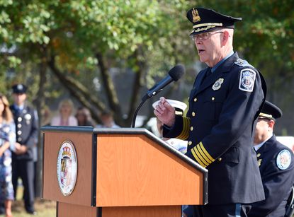 Anne Arundel Police Deputy Chief William Lowry has developed new procedures that ban officers from doing personal or political work for the county executive. Here, he speaks at a 2019 Sept. 11th memorial in front of police headquarters in Millersville.