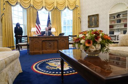 President Joe Biden, accompanied by Vice President Kamala Harris, signs the American Rescue Plan, a coronavirus relief package, in the Oval Office of the White House, Thursday, March 11, 2021, in Washington. (AP Photo/Andrew Harnik)
