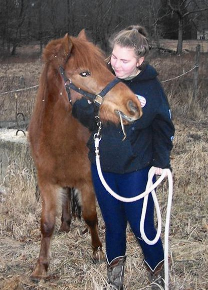 Cwen Cole, of Connecticut, is shown with a 2-year-old Chincoteague Pony that was saved from meat dealers by donations.