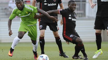 Levi Houapeu of Christos FC wins a battle against Chris Odoi-Atsem of D.C. United in the first half during a fourth-round match in the US Open Cup at the Maryland Soccerplex in 2017.