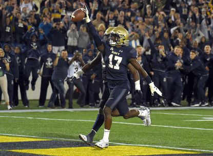 """Tony Brown Jr., seen scoring against Air Force in October, became the third """"striker"""" to announce his intent to transfer away from the Naval Academy."""