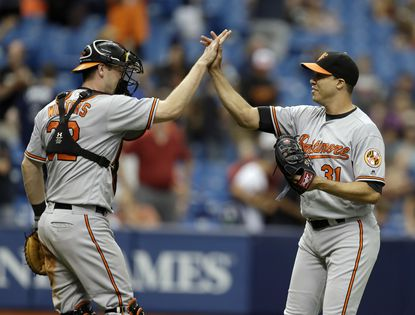 Baltimore Orioles starting pitcher Ubaldo Jimenez, right, high fives catcher Matt Wieters after closing out the Tampa Bay Rays during the ninth inning of a baseball game Monday, Sept. 5, 2016, in St. Petersburg, Fla. Jiminez pitched a complete game in the Orioles 7-3 win.