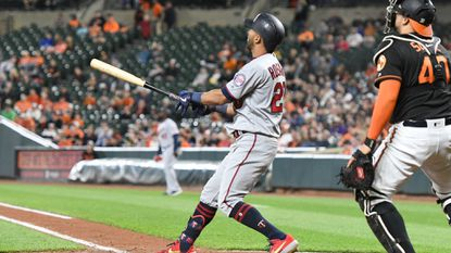 Eddie Rosario of the Twins hits a two-run home run in the third inning during game two of a doubleheader against the Orioles.