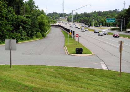 The Route 152 interchange with I-95, as seen from the hill where Trinity Church is located shows a busy roadway.