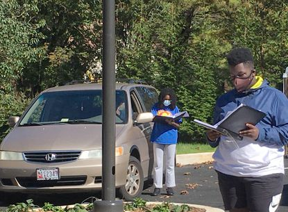 """Students with the Children's Chorus of Maryland and School of Music perform inside and outside vehicles during pandemic-induced """"car choir"""" rehearsals."""