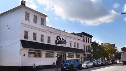 A Baltimore developer secured permission to demolish Eddie's of Mount Vernon and the neighboring buildings to make way for a mixed-use development on West Eager Street.