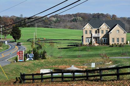 A high-end residential development off Triadelphia Road called Warfield II is adjacent to the Mullinex farm on Howard Road, which is visible behind the large house at right.