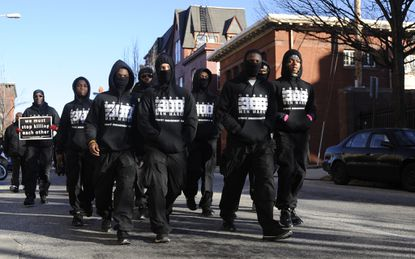 The 300 Youth COR leads the 300 Men March from Old Town Mall to the 3500 block of Park Heights Avenue, where Kendal Fenwick, the 295th homicide victim, was shot to death Monday night.