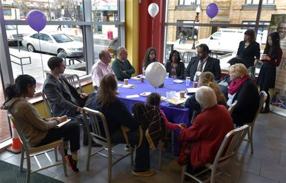"""Johns Hopkins Medicine and Called to CARE, a program for family caregivers, hold a """"Caregiver Cafe"""" at the Southeast Anchor Library on Eastern Avenue in Highlandtown as a way for the caregiver community to learn about resources in their area."""
